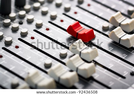 Sound mixer, red fader ahead - stock photo