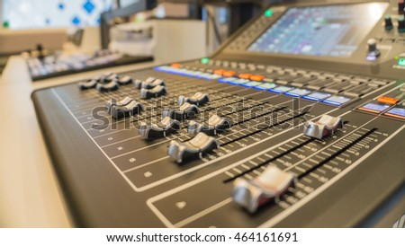 Sound music mixer control panel, selective focus., buttons equipment for sound mixer control with blurry background and selective focus