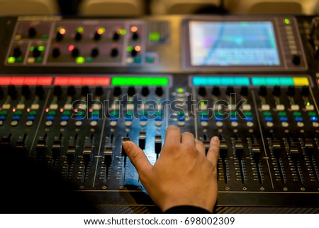 Sound technician and lights technicians control the music show in concert.Professional audio light & Sound Technician Lights Technicians Control Music Stock Photo ... azcodes.com