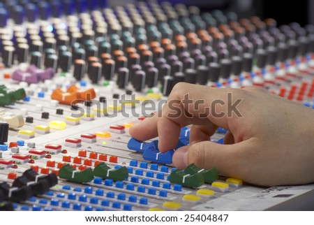 soundboard and human hand adjusting volume