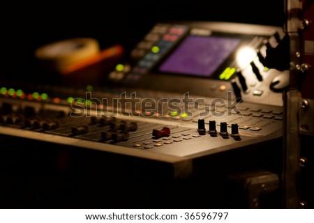 Soundboard mixer at a concert, shallow focus - stock photo