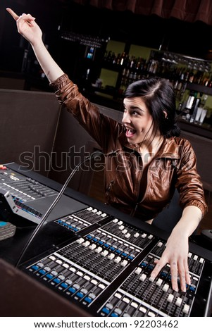 Soundboard technician doing a sound check - stock photo