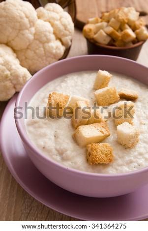 Soup cauliflower puree seasoned with bread croutons. - stock photo