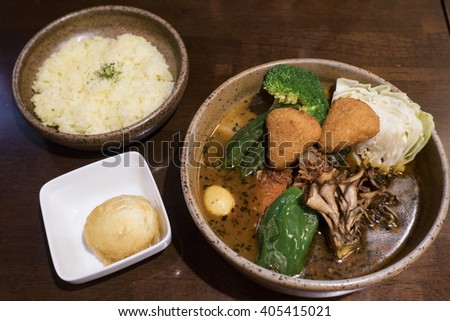 Soup Curry Chicken and Vegetables Bowl in Sapporo, Hokkaido, Japan  - stock photo