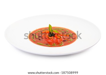 Soup from baked tomatoes with pesto close-up - stock photo