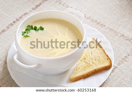 Soup in a cup with a bread slice