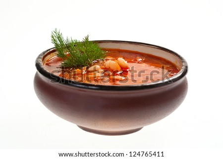 Soup in ceramic bowl on white background - stock photo