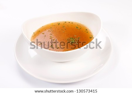 Soup in cup isolated on white - stock photo
