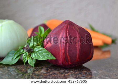 Soup ingredients : beets, carrots, onions, basil. Common garden vegetables. - stock photo