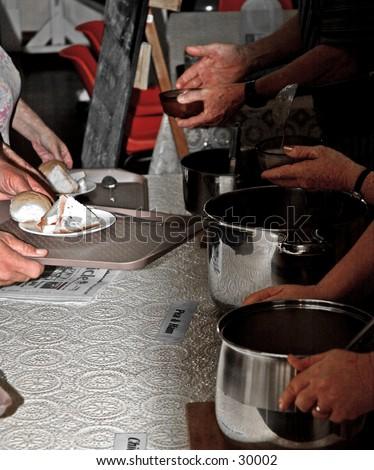 Soup kitchen volunteers 2 - stock photo