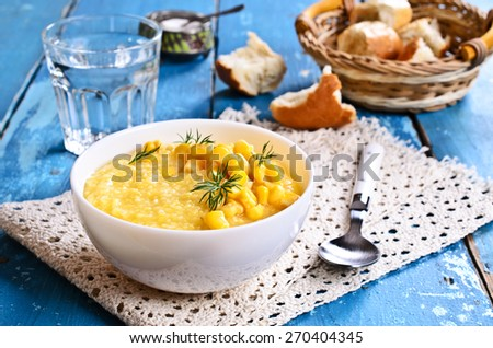 Soup made from ground beans corn yellow in the plate. - stock photo
