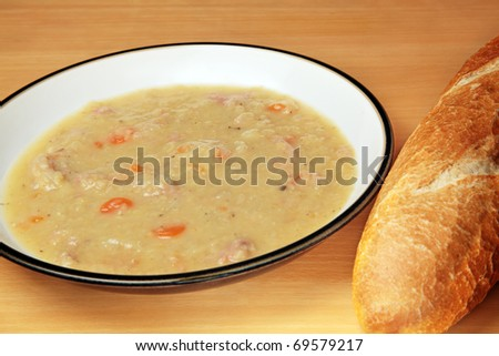 Soup made with red lentils, carrots, onion and ham