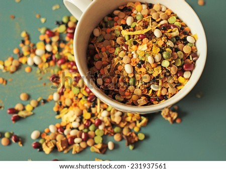 soup mix peas and bean in white cup on blue background - stock photo