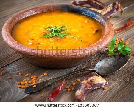 Soup of bulgur and lentils with smoked lamb ribs - stock photo