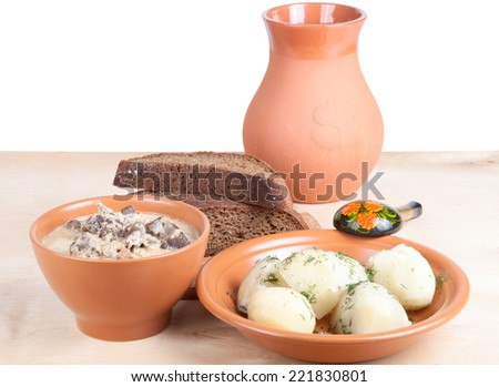 Soup of chiken liver and boiled potato with dill on a wooden board - stock photo