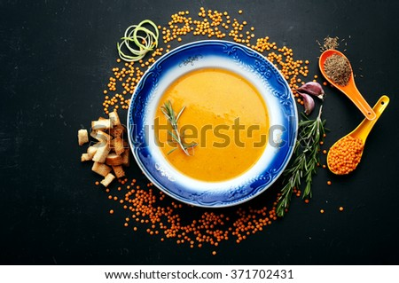 Soup of mashed red lentils. Close grain lentils, spices and herbs. Vegetarian concept - stock photo