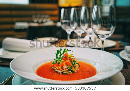 Soup on table in expensive restaurant, toned image