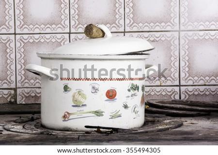 Soup pot on the wood-burning heating stove - stock photo