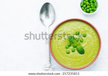 soup puree of green peas on a white background. tinting. selective focus - stock photo