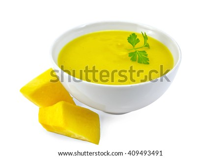 Soup-puree pumpkin with parsley in a white bowl, pumpkin slices isolated on white background - stock photo