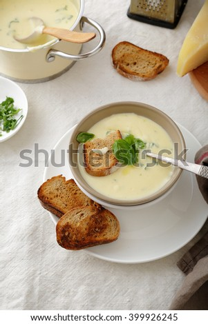 soup with bread in bowl on table - stock photo