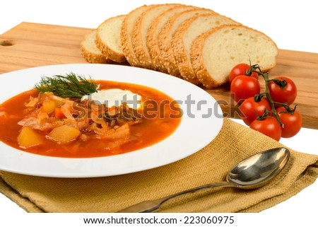 Soup with bread. with tomatoes, spoon, pieces of bread. - stock photo