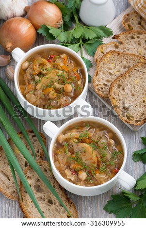 soup with cabbage and mushrooms, top view, vertical