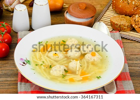 Soup with Chicken Meatballs and Noodles Studio Photo - stock photo