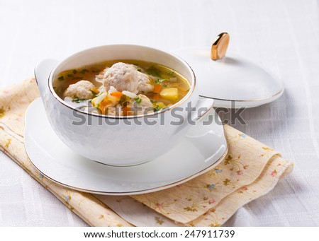 soup with chicken meatballs, rice and potatoes - stock photo