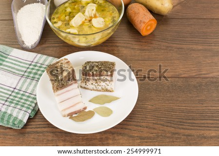 soup with dumplings and ham in a glass plate closeup