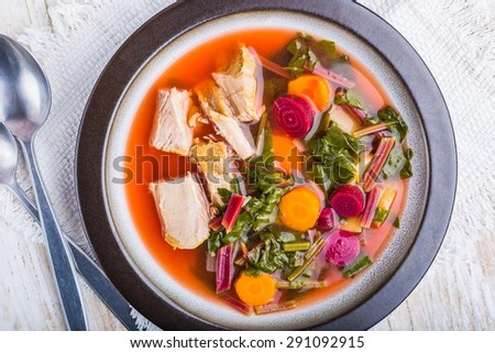 soup with fresh young beet in plate. studio shot - stock photo