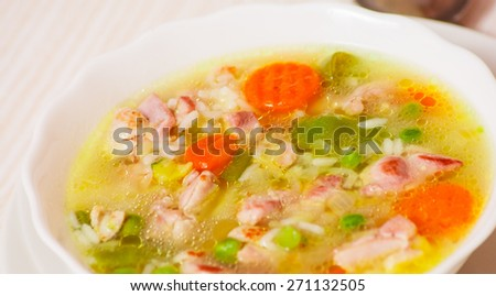 soup with meat, vegetables and rice - stock photo