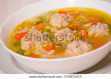 Soup with meatballs, rice and vegetables - stock photo
