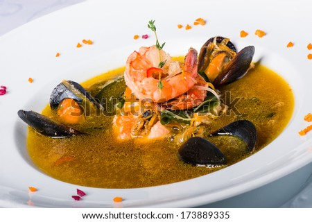 Soup with mussels, tiger shrimp, walleye, squid, salmon and vegetables