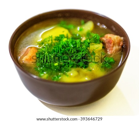 Soup with pork and potato in bowl isolated on white background - stock photo