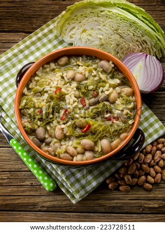 soup with rice savoy cabbage and beans - stock photo
