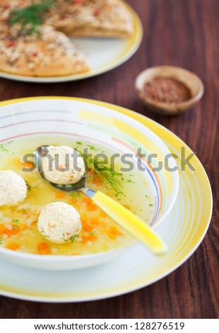 Soup with turkey meatballs, carrots and selery, selective focus - stock photo