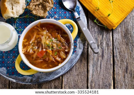 Soup with vegetables and sour cream on the plate. Selective focus. - stock photo