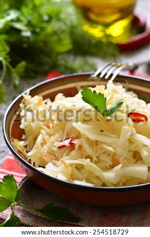 Sour cabbage in a ceramic bowl,traditional dish of russian cuisine.