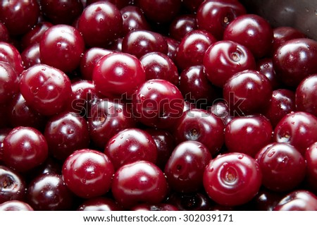 Sour cherries in a saucepan, prepared for cooking jam. - stock photo