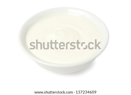 sour cream in bowl isolated on white background - stock photo