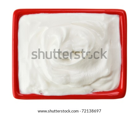 Sour cream in red small square plate, isolated on white - stock photo