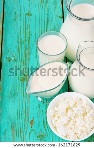 Sour cream, milk and cottage cheese. - stock photo
