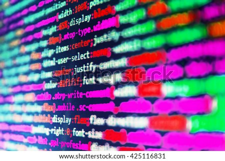 Source code photo. Software background.  Web site codes on computer monitor. Writing programming code on laptop. Developer working on program codes in office. Programming code.