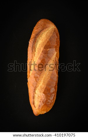 sourdough bread on black background