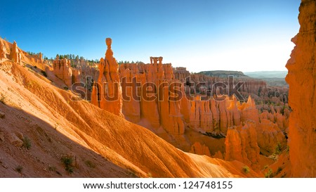 Souring hoodoos stand tall in the warm light of a summer dawn. - stock photo