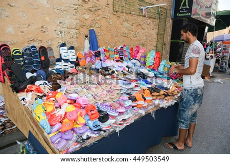SOUSSE,TUNISIA - June 28,2016: a Shoe Salesman at a street market in the old Medina