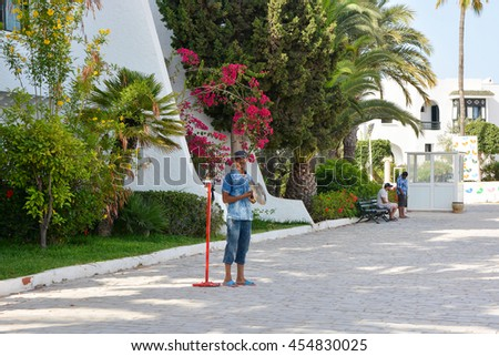 SOUSSE,TUNISIA - JUNE 29,2016:Man with birds Falcon in port El Kantaoui - stock photo