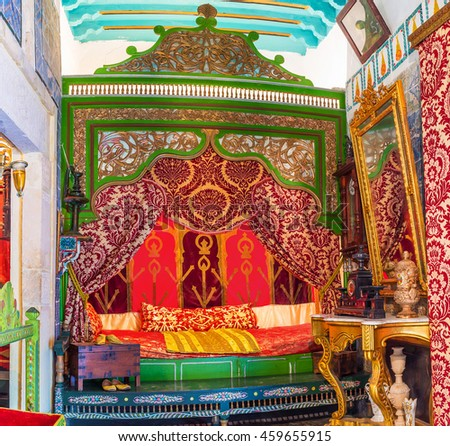 SOUSSE, TUNISIA - SEPTEMBER 3, 2015: The bedroom is decorated in different colors in traditional arabic style, on September 3 in Sousse.