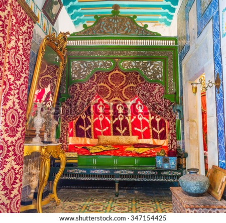 SOUSSE, TUNISIA - SEPTEMBER 3, 2015: The wife's bedroom in Dar Essid mansion with carved wooden bed and decorated walls and ceiling, on September 3, 2015 in Sousse.